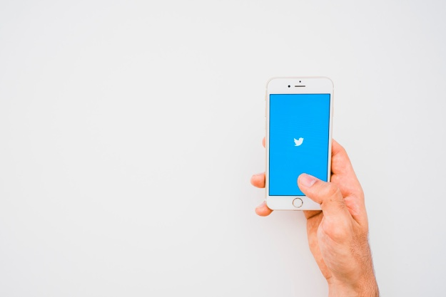 hand-phone-twitter-app-and-copy-space_23-2147651221